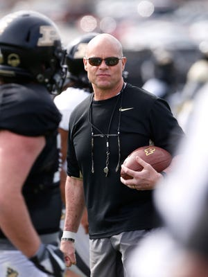 Linebackers coach and co-defensive coordinator Nick Holt watches as players warm up during Purdue spring football practice Monday, March 19, 2018, at the Bimel Practice Complex.