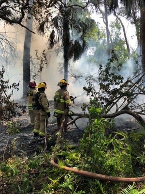 Naples firefighters put out a small fire behind the Naples Zoo at Caribbean Gardens on Monday afternoon.
