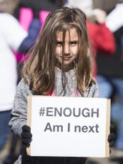 """Cora Youse, 5, asks """"Am I Next?"""" at the March For Our Lives event for gun control in Audubon, NJ on March 24."""