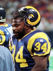 "Craig ""Ironhead"" Heyward smiles after he scored against the Giants in St. Louis on Oct. 2, 1997."