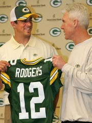 Aaron Rodgers, the Green Bay Packers' first-round pick, is introduced by GM Ted Thompson on April 24, 2005.