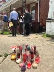 Members of the Wilmington Police Department on Friday canvassed the area near a fatal shooting, where a memorial marked the most recent act of violence.