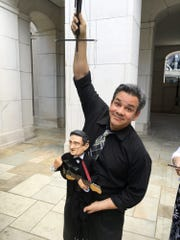 Wishing Chair Productions head puppeteer Brian Hull shows off the Johnny Cash puppet, which is part of the String City show at the Country Music Hall of Fame and Museum.