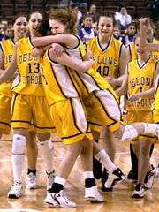 Members of the Delone Catholic girls basketball team converge on Jana Zinn, center left, and Meredith Cox, following the Squirettes championship victory over Bishop Guilfoyle in the 2004 state title game. Delone Catholic won three straight PIAA titles from 2003 to 2005.
