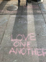 Messages of non-hate in chalk on the sidewalk greeted white nationalists when they arrived at the Foggy Bottom metro on Aug. 12, 2018, for the start of their parade.