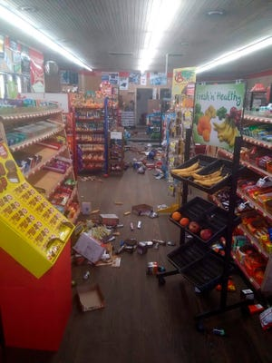 Various items litter the floor of the 4 Brothers Store in Sparta, N.C., where an early-morning earthquake shook much of state on Sunday.