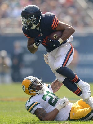 Packers safety Ha Ha Clinton-Dix tries to bring down Bears running back Matt Forte in the second quarter of a 2014 game in Chicago.