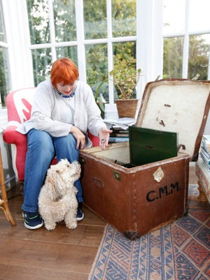 Jennifer Grant next to trunk she bought in estate sale at Agatha Christie's home. Diamond jewelry belonging to the crime novelist was discovered inside.