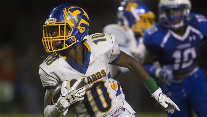 Rickards wide receiver Javon Wooten cuts up the sideline while returning a punt 86 yards for a touchdown against Godby at Gene Cox Stadium on Thursday.