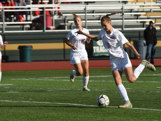 Red Hook's Grace Hennig, right, winds up a kick during