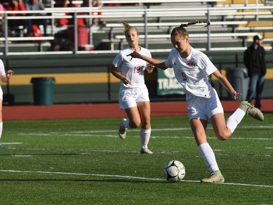 Red Hook's Grace Hennig, right, winds up a kick during the 2017 Section 9 Class A girls soccer final at Franklin D. Roosevelt High School.