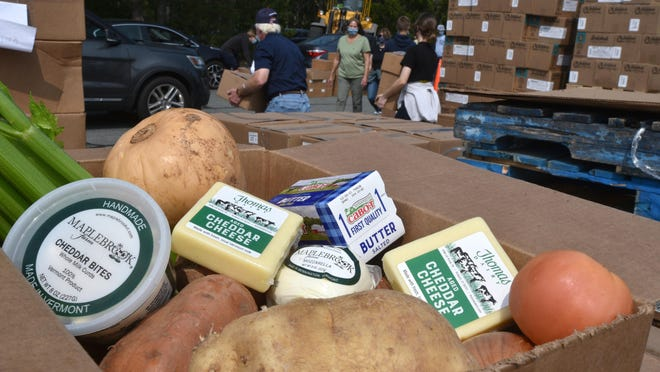 Chicken, cheese, milk and other produce and dairy items were handed out to families at Sandwich Hollows Golf Club Wednesday during a Farmers to Families food drive. For more photos, go to capecodtimes.com/photos