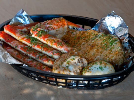 Crab legs cluster, steamed Cajun potato and a Cajun