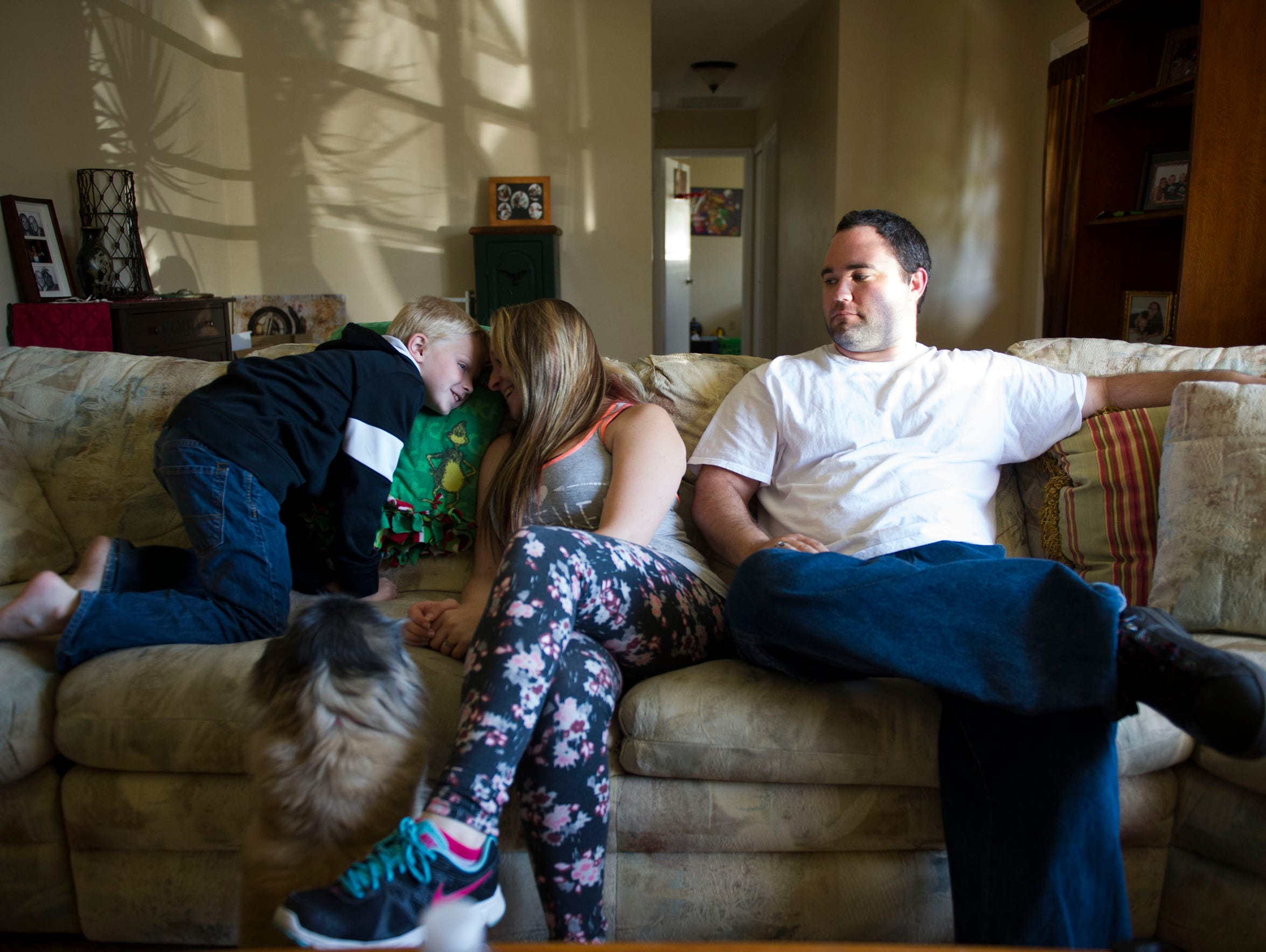 """Although David Merrill isn't the biological father of Landen, 6, (left), Merrill was in his life soon after his future wife, Jen, gave birth to him three days after Merrill's return from Iraq. The Merrills have been working on their marriage and were planning on a date that night, Feb. 25, 2016, but would eventually split up for good in September 2016. At times, they were a happy couple, David said, but """"something always seem really off. It seemed to be this constant up and down cycle."""""""