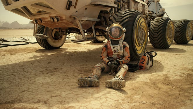"""This photo released by 20th Century Fox shows Matt Damon in a scene from the film, """"The Martian.""""  (20th Century Fox via AP)"""