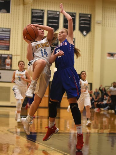 River Valley's Taylor Hecker shoots against defense
