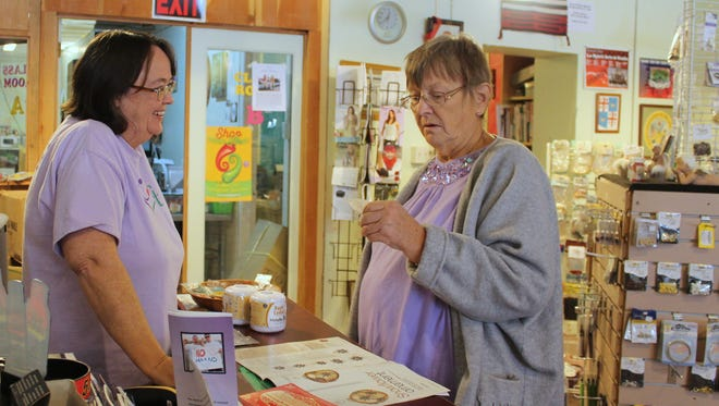 Pennie Espiritu, owner of Le Spirit, helps loyal customer Agnes Boas find beads for her craft project on Saturday afternoon. Espiritu is one of many business owners downtown that will be participating in Small Business Saturday, a movement which urges shoppers to support local businesses on Nov. 28.