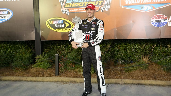Kevin Harvick celebrates winning the pole for the Oral-B USA 500 at Atlanta Motor Speedway.