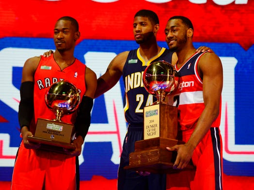From left, Terrence Ross, Paul George and John Wall celebrate after winning the dunk contest for the Eastern Conference. Wall was voted the dunker of the night.