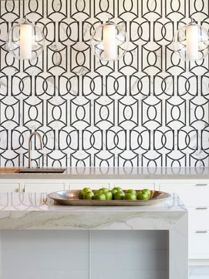 In an otherwise subdued kitchen, the Ann Sacks Liberty tile becomes a showstopping focal point.