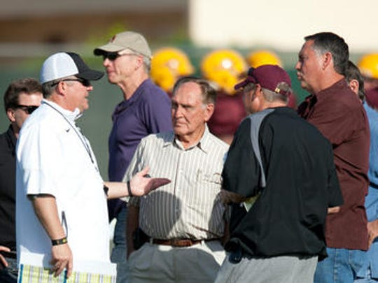Danny White, right, and his father Wilford White, center, talk with ASU football coach Todd Graham at a 2012 spring practice.