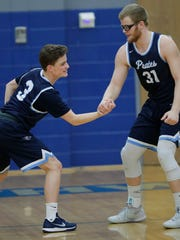 Bay Port's Jack Plumb (31) and Danny King (3) arm wrestle during player introductions against Green Bay Southwest at Southwest High School on Friday, December 22, 2017 in Green Bay, Wis. Adam Wesley/USA TODAY NETWORK-Wisconsin