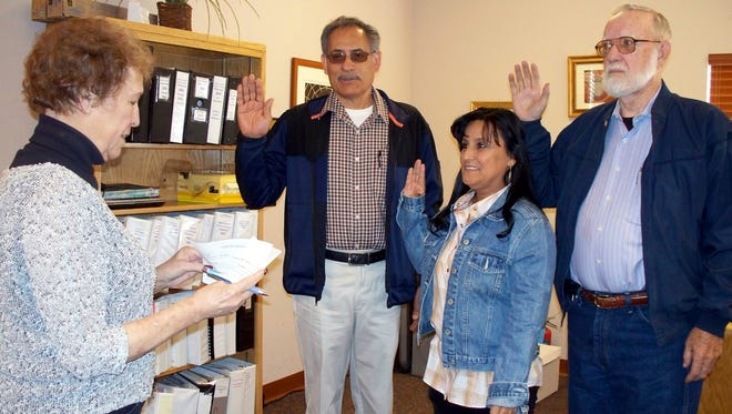 Columbus Municipal Clerk Cindy Varnhagen, left, swears in new members of the Columbus Village govrning body Roberto Gutierrez, four-year trustee; Rachel Gomez, Columbus Municipal Judge, four-year term; and Don Farber, two-year trustee. The new officials were elected at the March 1, Municipal elections recently held in the village.