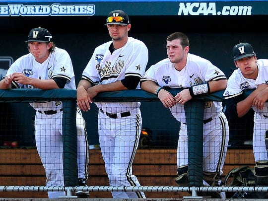 L to R, Vanderbilt players Carson Fulmer, Tyler Beede, Jason Delay and Karl Ellison watch front he dugout at the end of the ninth inning against Texas at the College World Series at TD Ameritrade Park in Omaha, Neb., Friday, June 20, 2014. Vanderbilt lost 4-0.