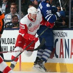 Landon Ferraro of the Detroit Red Wings, left, makes a hit against the Toronto Maple Leafs on Nov. 6, 2015, in Toronto.