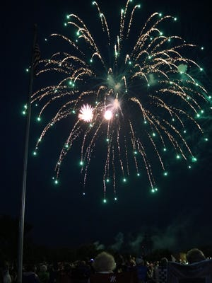 The Oak Harbor Area Chamber of Commerce hosted a dazzling fireworks display to light the night over the Portage River on Tuesday.