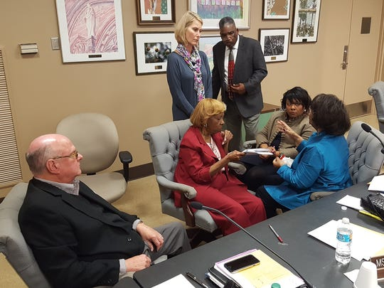 Montgomery County Board of Education members talk during