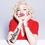 """This CD cover image released by Interscope Records shows the delux album """"Rebel Heart,"""" the latest release by Madonna."""