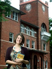 """Rachel Held Evans, author of """"Evolving Growing up in Monkey Town,"""" is pictured in front of the Rhea County (Tennessee) Courthouse, the site of the 1925 Scopes monkey trial, on July 19, 2010. Evans died Saturday, May 4, 2019, after a brief illness."""