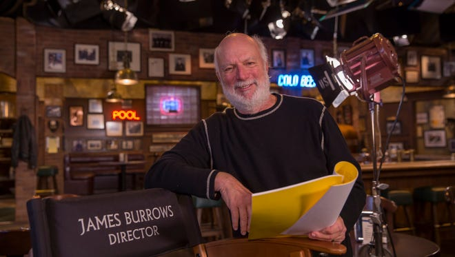 'Crowded' director James Burrows stands on the sitcom's bar set, which echoes his earlier comedy, 'Cheers.'