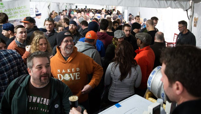 Tents outside of Lovin' Cup in Henrietta are packed for the Homegrown Festival on Saturday, January 9, 2016.