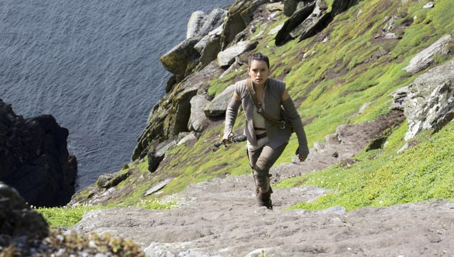 """Rey (Daisy Ridley) climbs the Jedi steps to meet an old icon in """"Star Wars: The Force Awakens."""""""