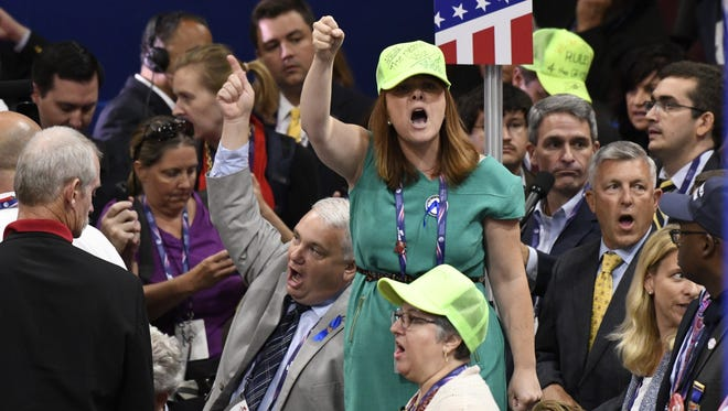 Members of the Virginia delegation vote on adoption of the rules during the first day of the 2016 Republican National Convention on Monday at Quicken Loans Arena in Cleveland.