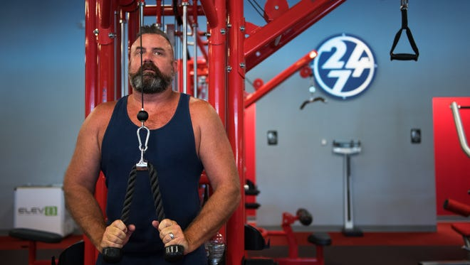 Tom Pollard works out at the Workout Anytime location in North Greenville on Friday, July 29, 2016.