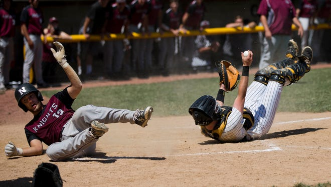 Jasper catcher Adam Hedinger showed the ball after hanging onto it following a collision with Northview's Brigham Booe on the final play of the game during Saturday's Class 3A baseball semistate game at Ruxer Field in Jasper. Jasper defeated Northview 3-2 in 10 innings.