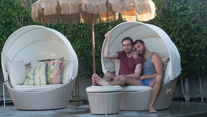 """Kit Williamson (left) and John Halbach of """"EastSiders,"""" the Netflix series they star in, relax poolside at Burton House in Palm Springs in September. The desert city is one of their favorite weekend getaways."""
