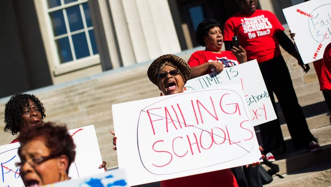 Stella Bullard, a resident of the California neighborhood and parent advocate with BAEO, joined a rally on the steps of City Hall downtown to voice her support for charter schools in Kentucky.  The rally was organized by the Black Alliance for Educational Options, or BAEO.