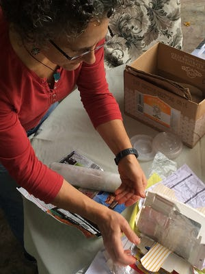 """Salem artist Meg Rowe creates art from recycled and discarded items for """"From Cart to Art,"""" Straub Environmental Center's fall fundraiser. The event is Nov. 14 at Salem Convention Center."""