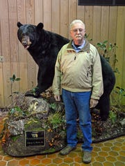 Bruce Headley stands next to the taxidermist's finished product: a black bear Headley shot and donated to N.J. Division of Fish and Wildlife. The bruin weighed 829 pounds.