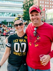 Heather Griffin, 48, and Mark MAnning, 48, both of Des Moines, showing off their team colors at the Touchdown Tailgate hosted by Cowles Commons.
