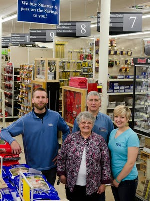 Linda and Rick Klein, center, are co-owners of Frank's Hardware in Stevens Point. They are pictured with children TJ, left, and Sarah, right.