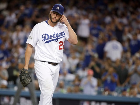 Los Angeles Dodgers starting pitcher Clayton Kershaw is removed during the seventh inning of Game 1 of the baseball team's National League Division Series against the Arizona Diamondbacks in Los Angeles, Friday, Oct. 6, 2017. (AP Photo/Jae C. Hong)