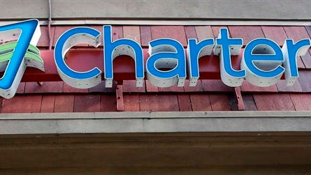 This Tuesday, March 31, 2015 photo shows signage at a Charter Communications facility in Glendale, Calif. Charter Communications Inc. is buying fellow cable operator Bright House Networks LLC in a deal valued at $10.4 billion.