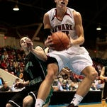 Joran Dartis shoots the ball in the Division I district finals against Dublin Coffman. The Wildcats lost 61-50.