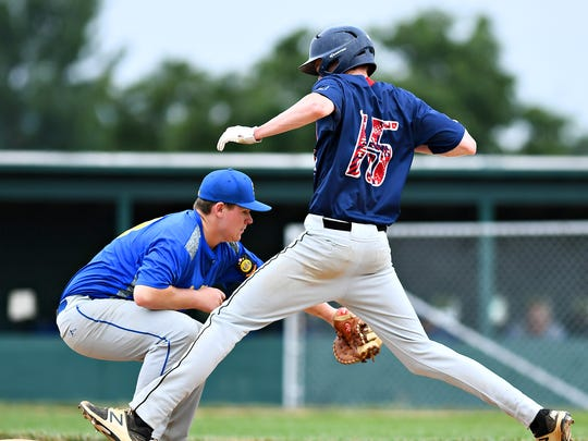 Stewartstown's T.J. Grimsley, left, looks to catch