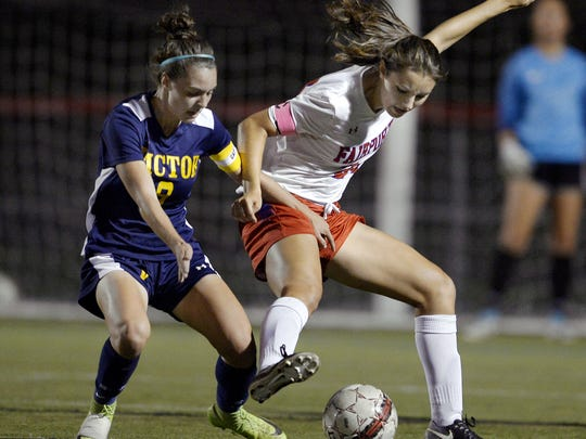 Fairport's Claire Myers, right, reaches for the ball